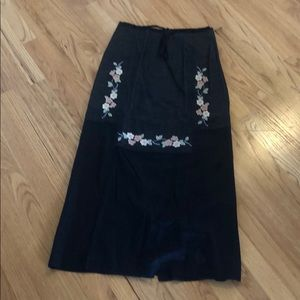 Black skirt with pastel embroidery